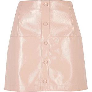 Pink patent buttoned mini skirt