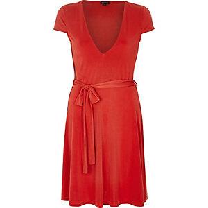 Red slinky skater dress