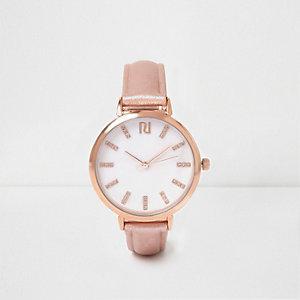 Montre doré rose à bracelet avec barres en T