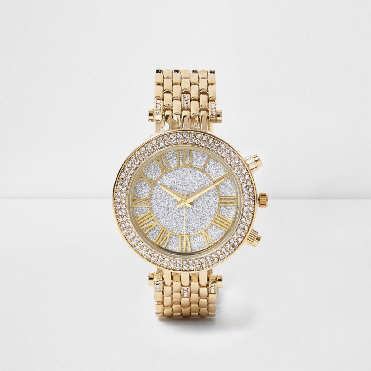 Goldene, strassverzierte Uhr
