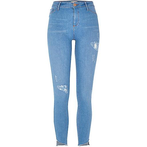 Molly - Helderblauwe jeans met asymmetrische zoom