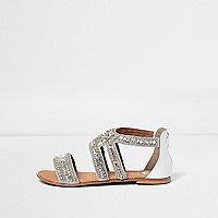 Sandales blanches à brides ornées