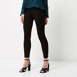 Petite black pin-tuck leggings