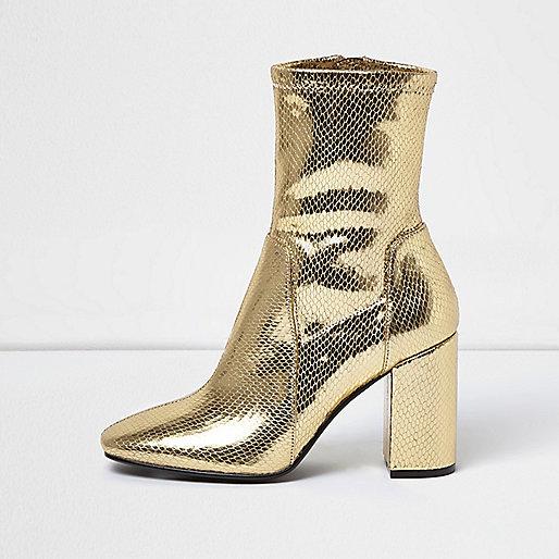 Gold sock boot with block heel