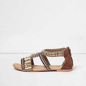 Goudkleurige verfraaide sandaal