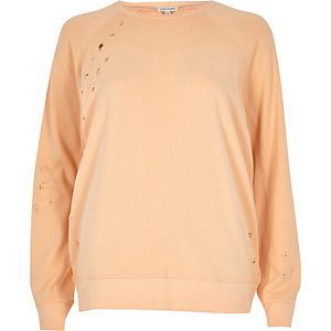 Light coral distressed fleece sweatshirt