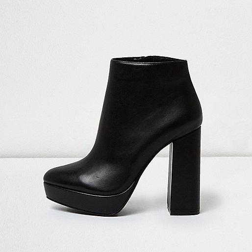 Zwarte leren laarzen met plateauzool en hak