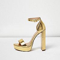 Sandales dorées à talons et plateforme