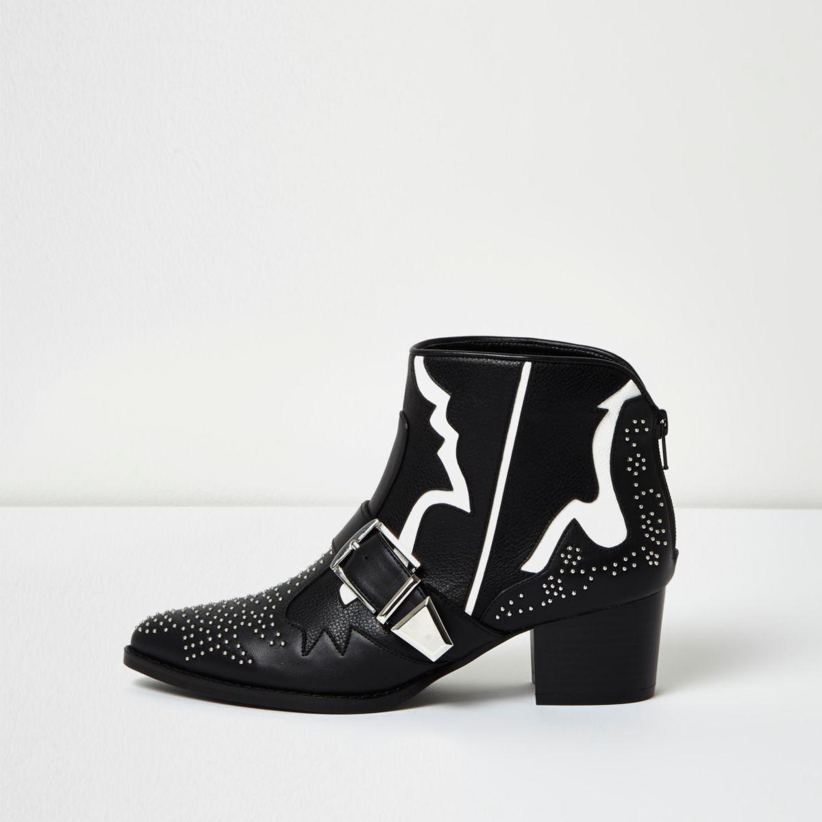 Bottes noires cloutées style western avec bande blanche