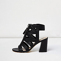 Black zip front strappy shoe boots