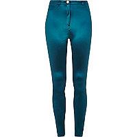 Glanzende donkerblauwe superstrakke broek