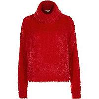 Rode pluizige pullover met losvallende col