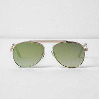 Lunettes de soleil effet miroir vertes à barre supérieure dorée