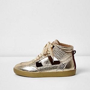 Goudkleurige hoge sneakers met uitsnede