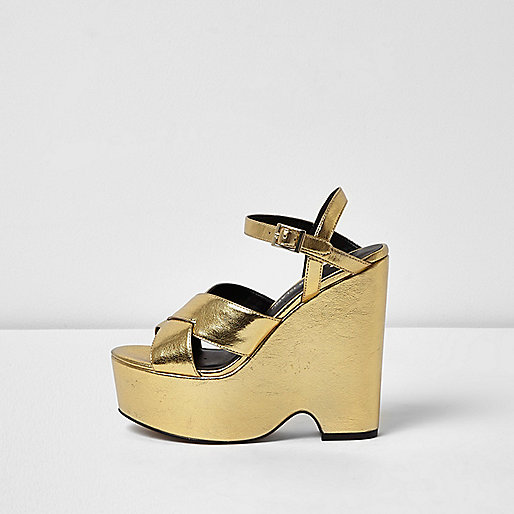Gold cross strappy platform wedges