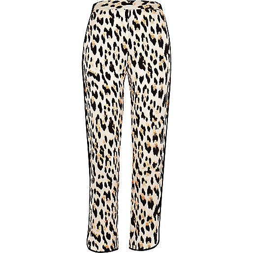 Pantalon doux fuselé imprimé léopard