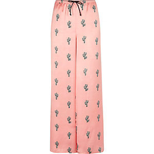 Roze pyjamabroek met cactusprint