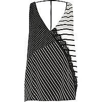Zwart-wit gestreepte camitop met T-bandje