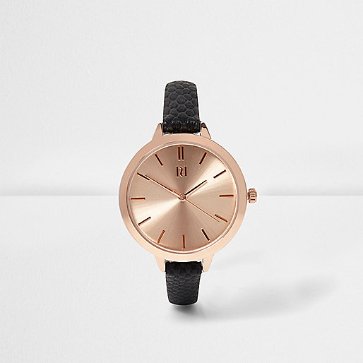 Black skinny strap rose gold tone watch