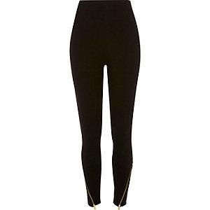 Zwarte legging met hoge taille ritsjes bij de enkel