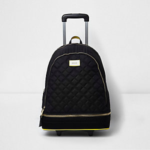 Black quilted backpack on wheels