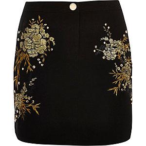 Mini-jupe noire à fleurs brodées cloutée