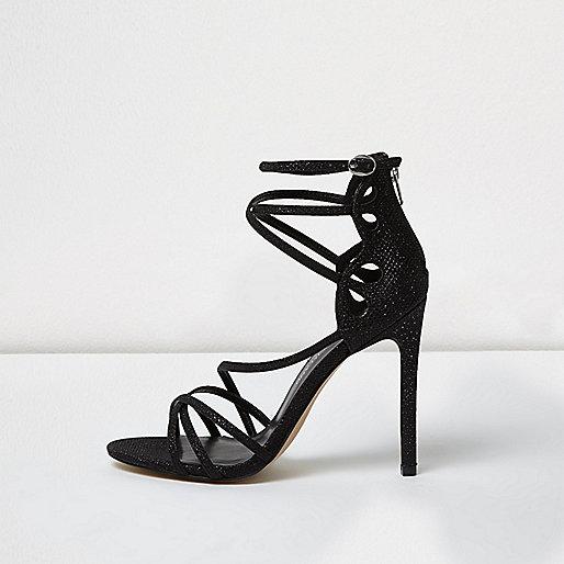 Sandales noires à paillettes effet cage