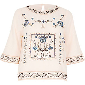 Light pink flared sleeve embroidered top