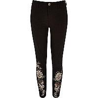 Molly – Schwarze Hose mit Blumenverzierung