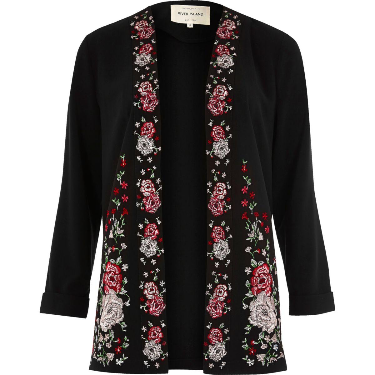 Manteau long noir à fleurs brodées
