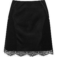 Black lace hem panel mini skirt