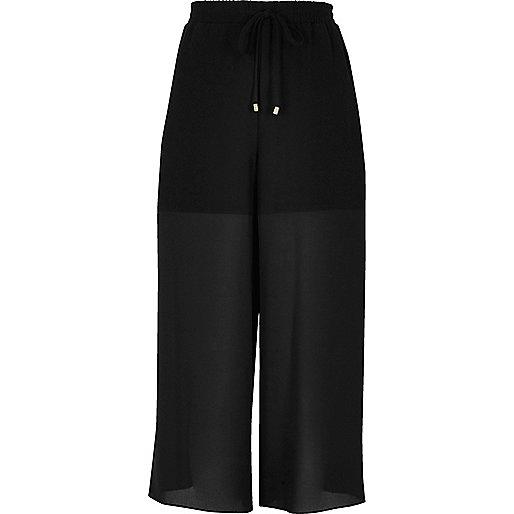 Jupe-culotte noire à empiècements en mousseline