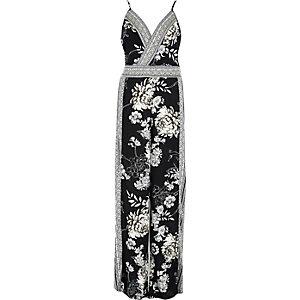Schwarzes Overall mit Blumenstickerei