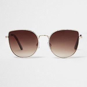 Goldene Sonnenbrille mit braunen Gläsern