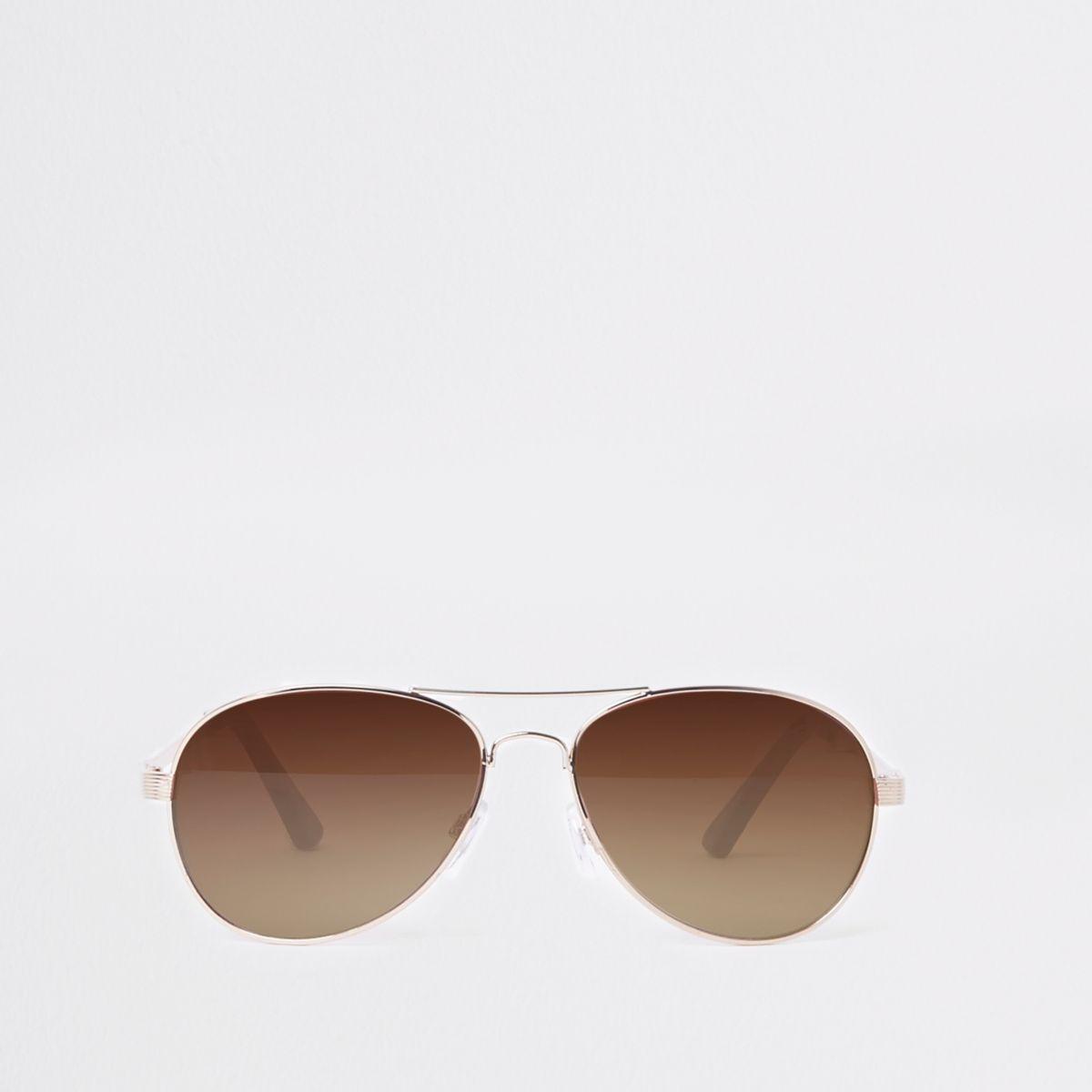 Goudkleurige pilotenzonnebril met bruine glazen