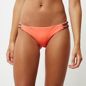 Coral embellished strap bikini bottoms