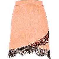Pink faux suede lace hem mini skirt