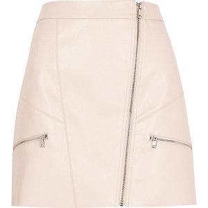 Mini-jupe en cuir synthétique rose zippée