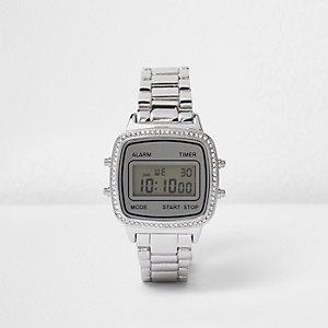 Zilverkleurig digitaal horloge bezet met siersteentjes