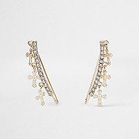 Bijoux d'oreille dorés avec croix et strass