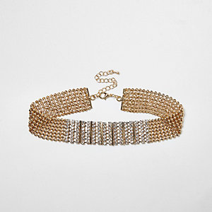 Gold tone rhinestone encrusted choker necklace