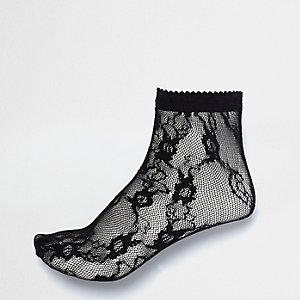 Socken aus schwarzer Spitze