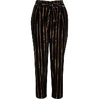 Pantalon fuselé rayé noir métallisé avec lien à nouer