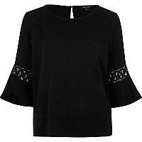 Black crochet flute sleeve top
