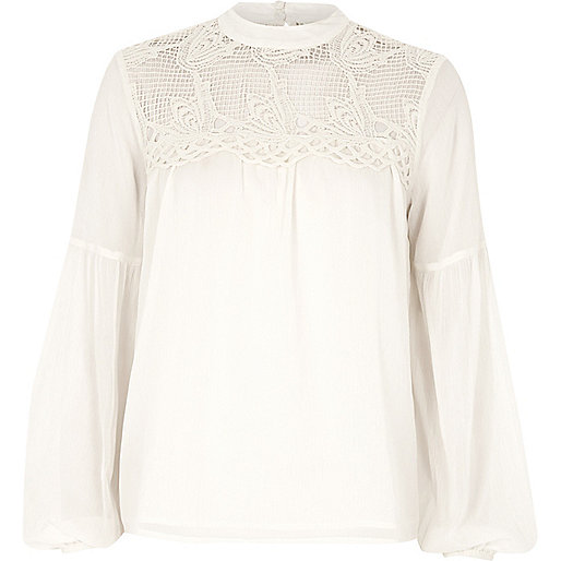 Cream cutwork bell sleeve blouse