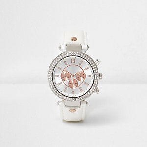 Montre blanche incrustée de pierres couleur or rose