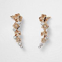 Bijoux d'oreilles dorés motif fleur