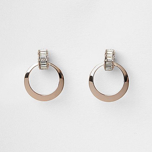 Boucles d'oreilles circulaires couleur or rose avec baguette
