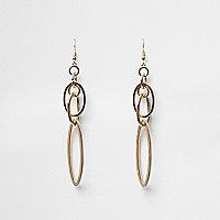 Pendants d'oreilles dorés avec anneaux entrelacés