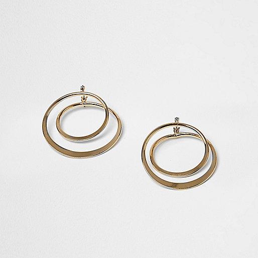 Gold tone twist hoop earrings